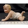 Heubach small 'Piano Baby' painted bisque porcelain